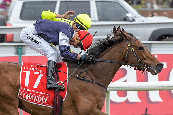 Almandin, with Kerrin McEvoy onboard, salutes in the 2016 Melbourne Cup. It was another joyous Melbourne Cup day for larger than life owner Lloyd Williams.