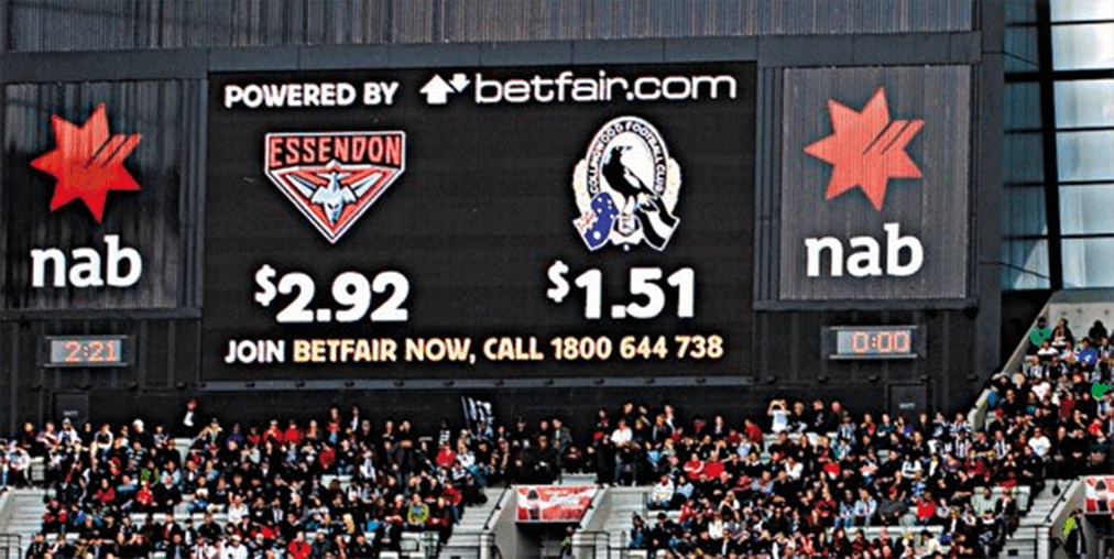 Live odds on the scoreboard at an AFL match