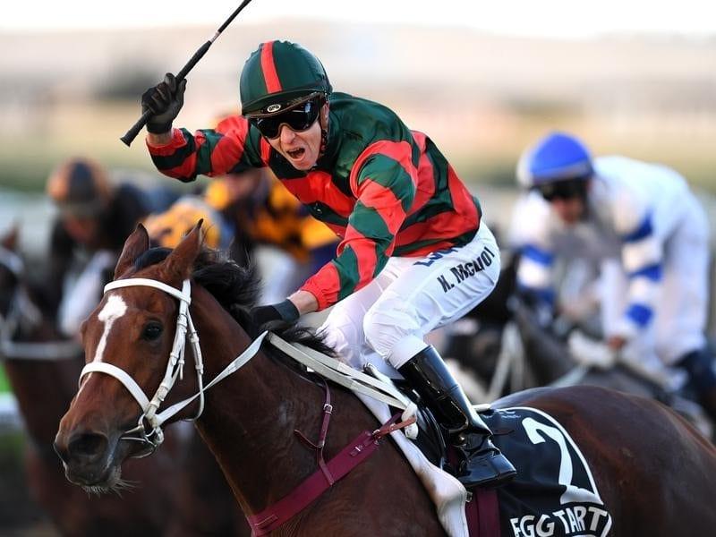 Jockey Kerrin McEvoy celebrates riding Egg Tar