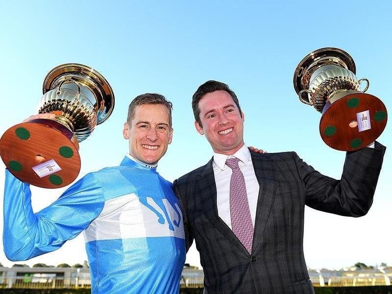 Jockey Blake Shinn and co-trainer Adrian Bott.