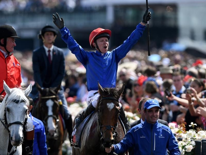 Jockey Kerrin McEvoy celebrates as he returns to the mounting yard.