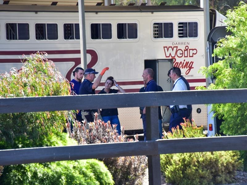 Police are seen at Darren Weir Stables in Miners Rest, Victoria