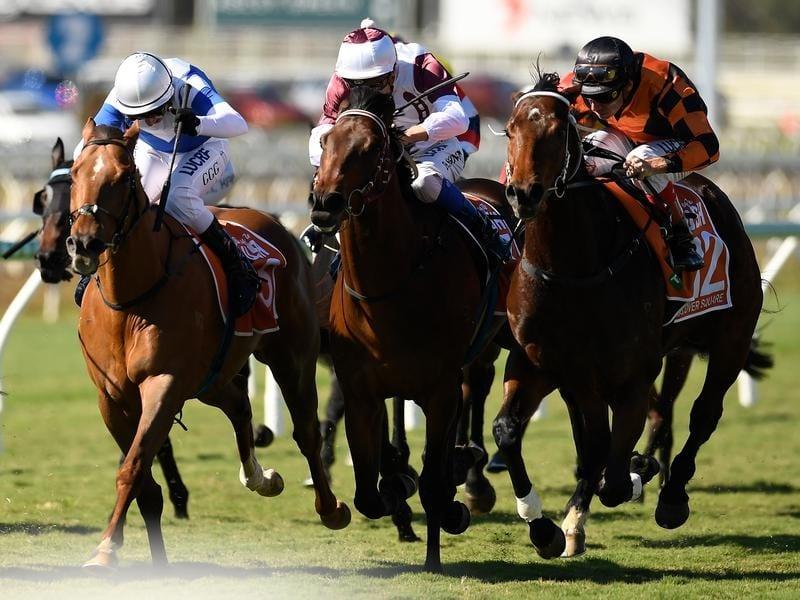 Jockey Michael Cahill rides Hanover Square to victory
