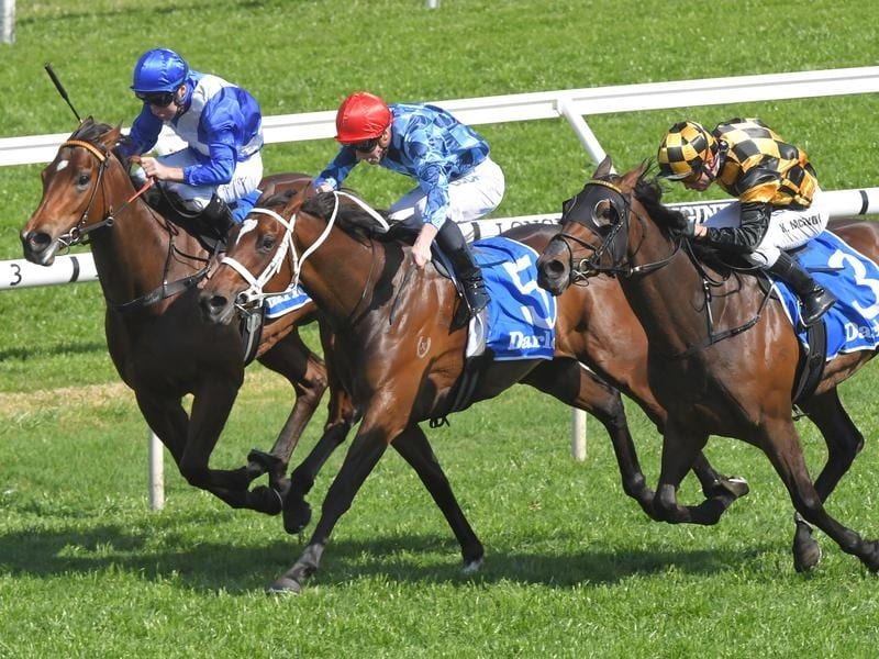 Funstar (centre) wins the Group Two Tea Rose Stakes.