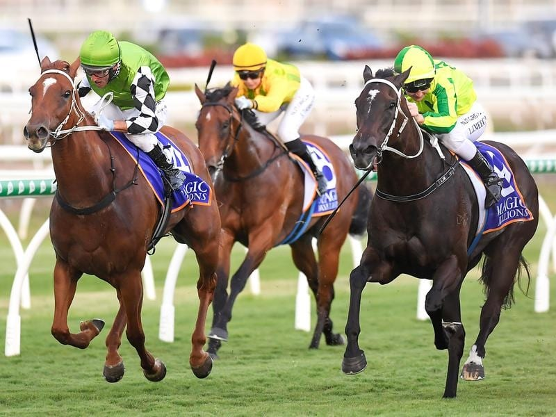 Jockey Damien Oliver rides Tahitian Dancer (left) to victory