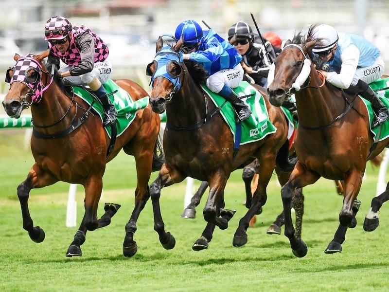 Jockey Jason Collett rides Great Powers (far right)