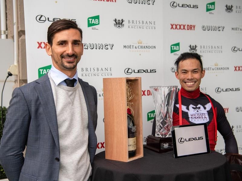 Trainer Michael Costa and jockey Allan Chau after the Gunsynd Classic.