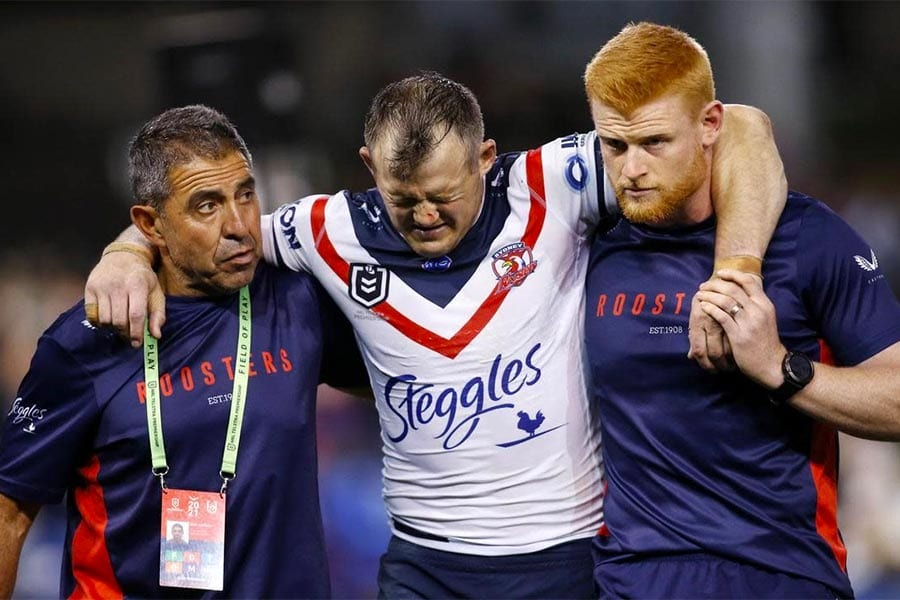 Roosters trainers with Brett Morris after career-ending ACL tear